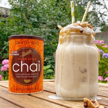 Milkshake with toppings and a can of David Rio chai mix