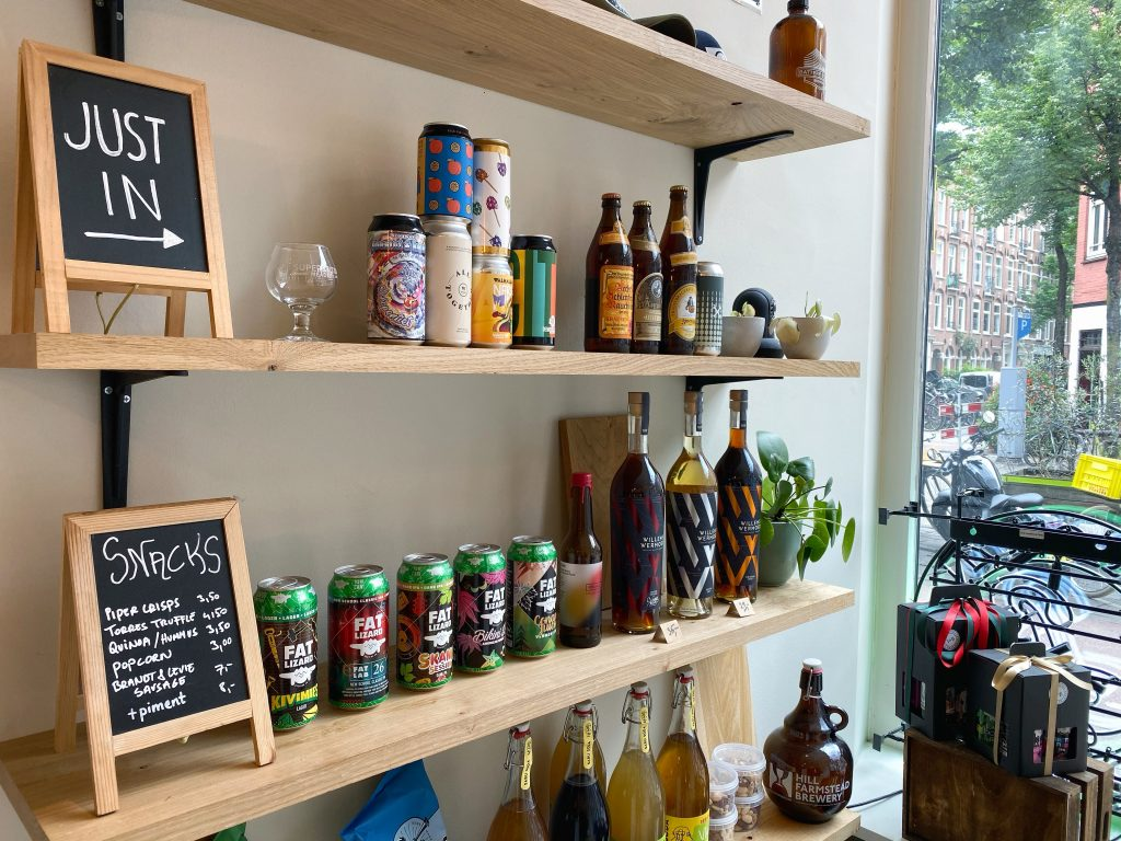 beer shop shelves with drinks and snacks