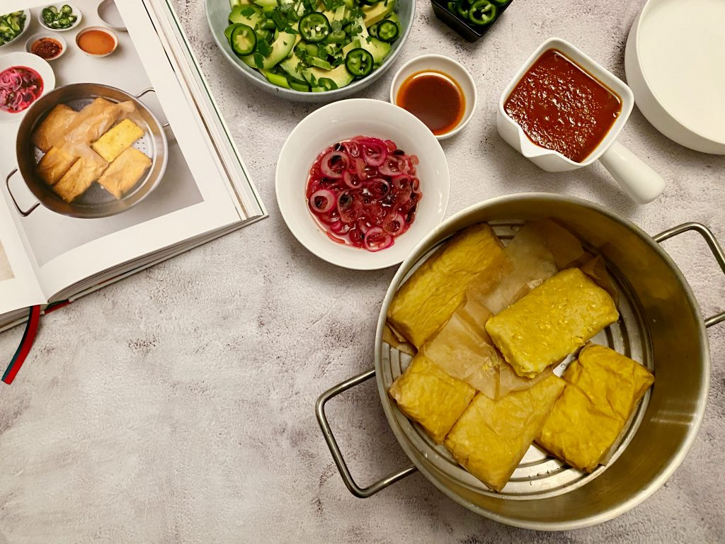 Tamales in steam pan with sides